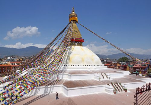 Bouddhanath stupa with Tibetan flags as seen during North Nepal Kathmandu Day tour