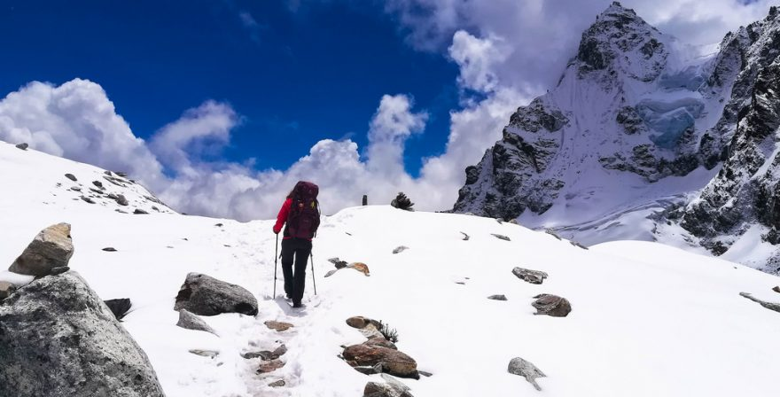 A trekker walking through the snow in Annapurna Circuit Trek, North Nepal Tours and Travels