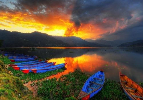 Sunset view of Phewa lake as seen in during Pokhara lake tour by North Nepal Travel Pokhara tour package,