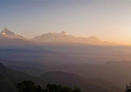 Sunrise over Annapurna Mountain range as seen from Panchase view point during Panchase Trek on North Nepal Trekking package