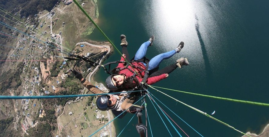 Aerial view of Pokhara with a lady having fun and fly like a bird in North Nepal's Paragliding 4 days package