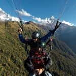 Paragliding flying over Mardi Himal cross country Tandem flight and Mt. Macchapuchre and Annapurna South on back in North Nepal's Paragliding 4 days package