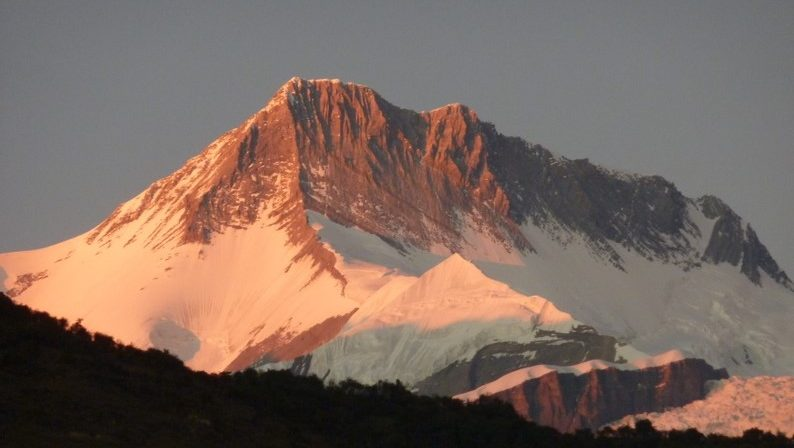 Sun-kissed Annapurna II 7,939 m, seen from Sikles Village