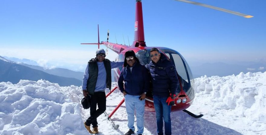 Asian tourist taken a picture with Helicopter at 3700m altitude-Jomsom Muktinath Heli Tour.