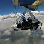 Ultralight in pokhara Nepal with majestic view of the Himalayan giants, Dhaulagiri mountain, Annapurna mountain view and clear blue sky on North Nepal's Ultralight package