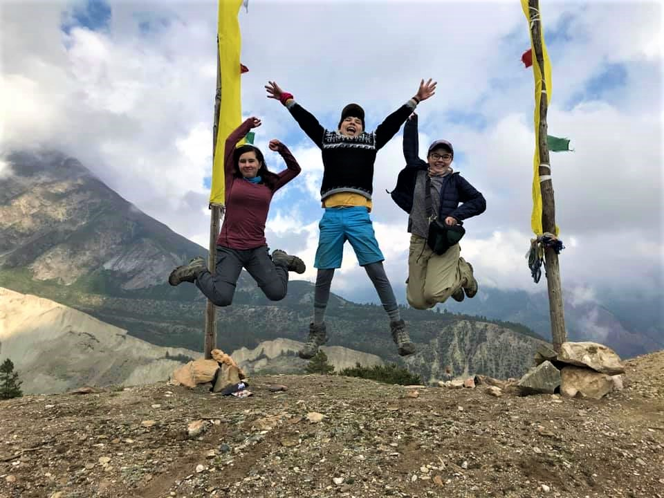 Happy kids posing for pictures in Himalayan route to Annapurna circuit trek, Nepal. June 2019.