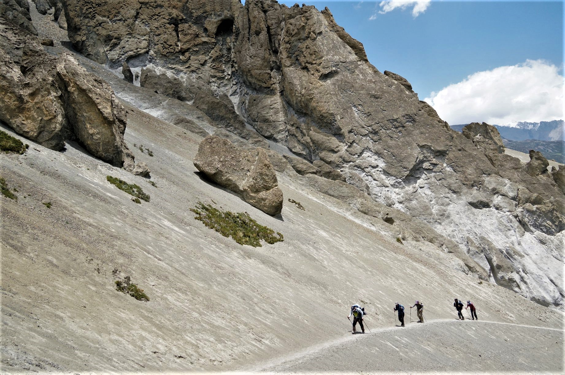 Trekkers are crossing the Landslide zone on the way to Tilicho Base camp from Khangsar on our fifth day of the family trek in Annapurna region june 2019.