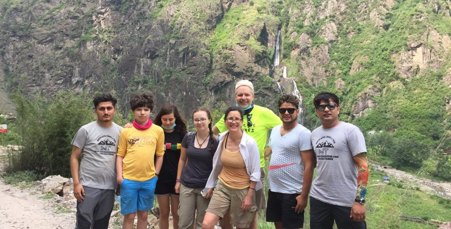 Trekkers with Nepalese guide and porters on the way to Chame from Besisahar, Annapurna Circuit trek 2019.