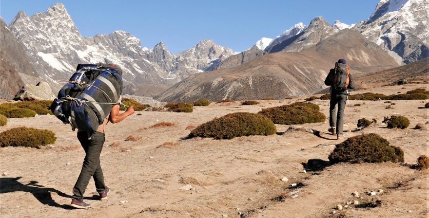 Nepalese Guide and Porter with backpack Guiding their guest in Everest region trek.