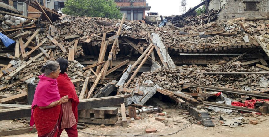 Pedestrians walking past a building destroyed by earthquake, Is Nepal Safe to Travel, North Nepal Travel and Treks